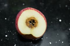 Cut out apple rotten. In the middle Royalty Free Stock Photos