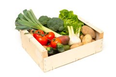 Cut Out of Assorted Fresh Vegetables in Wooden Crate Stock Photos