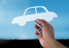 Cut out car in hand in sky. Digital composite of Cut out car in hand in sky Royalty Free Stock Photos
