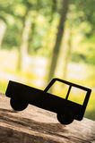 Cut out car silhouette over forest background Stock Image