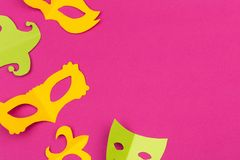 Cut out colored paper figures for the holiday Mardi Gras, colour background. royalty free stock photography