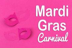 Cut out colored paper figures for the holiday Mardi Gras, colour background. stock photo