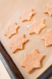 Cut out cookie dough for Christmas cookies Stock Photo