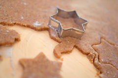 Cut out cookie dough for Christmas cookies Royalty Free Stock Images