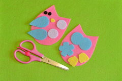 Cut-out details owl toy. Scissors. Fabric crafts for kids step by step. How to make a cute felt bird toy Royalty Free Stock Image