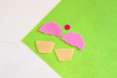 Cut out felt details for cake decor. Easy kids crafts project. Sewing Stock Images