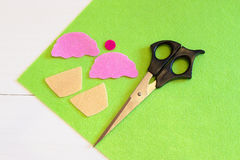 Cut out felt details for cupcake toy, scissors. Easy kids DIY project. Royalty Free Stock Photos