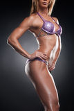 Cut out of female bodybuilder body. Royalty Free Stock Images
