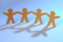 Cut-out figures together Royalty Free Stock Image