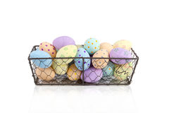 Cut Out of Hand-Painted Eggs in Chicken Wire Tray. Cut out of hand-painted eggs in a chicken wire tray royalty free stock photography