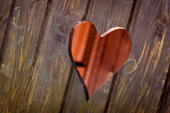 Cut out heart shape. Wooden board with cut out heart shape stock photo