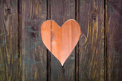 Cut out heart shape. Wooden board with cut out heart shape stock images