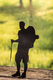 Cut out of hiking man silhouette over nature Royalty Free Stock Image