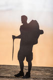 Cut out of hiking man silhouette over nature Stock Photos