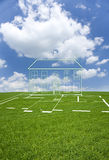 Cut out house in grass field Royalty Free Stock Photography