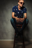 Cut out image of a young fashion man sitting on a stool Stock Photo