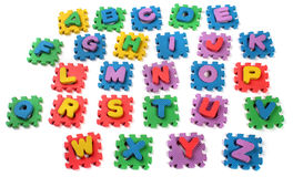 Cut out letters of toy plastic alphabet Royalty Free Stock Photos