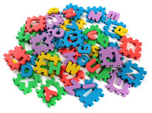 Cut out letters of toy plastic alphabet puzzle Stock Photography