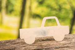 Cut out paper car silhouette over forest Stock Image