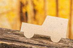 Cut out paper car silhouette over forest Royalty Free Stock Photo