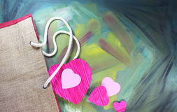 Cut out paper heart from a jute bag. With painted background Royalty Free Stock Photo