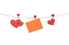 Cut out paper hearts fixed with clothespins Stock Image