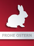 Cut out rabbit shape with Frohe Ostern text Royalty Free Stock Photo
