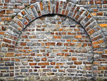 Cut Out Rocks In Wall With Arched Brickwork Royalty Free Stock Photo