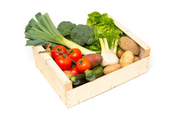 Cut Out of Variety of Fresh Vegetables in Wooden Crate Stock Photo
