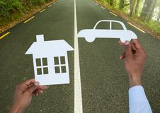 Cut outs house and car on road Stock Photos