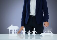 Cut outs of house family and car with model Royalty Free Stock Photo