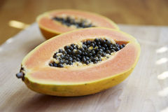 Cut Papaya. With on board with seeds Royalty Free Stock Image