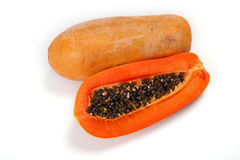 Cut papaya showing the seeds Stock Images
