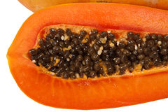 Cut papaya showing the seeds within Royalty Free Stock Photography