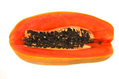 Cut papaya on white background. Cut papaya with seeds on a white background Royalty Free Stock Photography