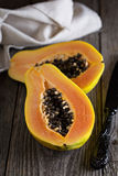 Cut papaya on a wooden table Royalty Free Stock Images