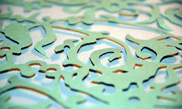 Cut Paper Abstract. Decorative design made from selective focus on green paper cut into a lacy design Royalty Free Stock Photo