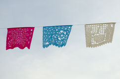 Cut paper decoration. Mexican typical decorative papers called Papel picado Royalty Free Stock Photos