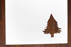 Cut paper in fir-tree shape on table Stock Image