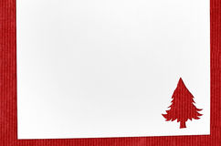 Cut paper in fir-tree shape on table Royalty Free Stock Photo