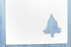 Cut paper in fir-tree shape on table Stock Photos