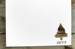 Cut paper in fir-tree shape on table Royalty Free Stock Photos