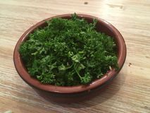 Cut parsley in a bowl Stock Photos