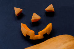 Cut parts of a smiling scary halloween pumpkin Stock Images
