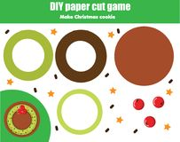 Cut and paste children educational game. Paper cutting activity. Make a New Year, Christmas cookie with glue. DIY worksheet.  Royalty Free Stock Photos