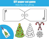 Cut and paste children educational game. Paper cutting activity. Make a New Year, Christmas gift tag. DIY worksheet.  Royalty Free Stock Images