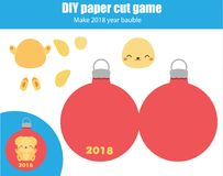 Cut and paste children educational game. Paper cutting activity. Make a New Year 2018 yellow dog bauble with glue. DIY worksheet.  Royalty Free Stock Photography