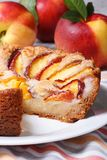 Cut peach pie on the background of fresh fruit Royalty Free Stock Image