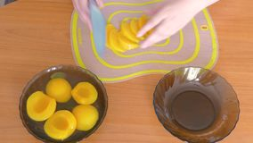 Cut peach into slices. Cut into slices marinated peach stock footage