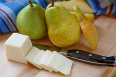 Cut Pear with Whole Pears and Sliced Cheese Stock Image